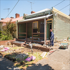 abbotsford-7655-ps-w (pw-pix) Tags: street sun house yard concrete person glasses construction shadows walk working sunny australia melbourne victoria lunchtime holes overalls worker renovations renovation jackhammer abbotsford safetyglasses