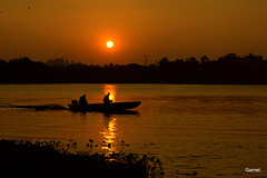 Troubled waters (kevinsaviogarnet75) Tags: sunset india beautiful silhouette boats bangalore ulsoor