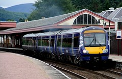 Scotrail Class 170 'Turbostar' No. 170431 departs Aviemore Station platform 1 with a afternoon train to Inverness.  (steamdriver12) Tags: park train 1 scotland highlands afternoon platform scottish august scotrail class national aviemore 170 inverness 2010 cairngorm turbostar departs 170431