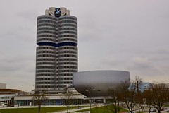 BMW Tower and BMW Museum in Munich, Bavaria, Germany (UweBKK ( 77 on )) Tags: world city sky urban tower museum architecture buildings germany munich mnchen bayern deutschland bavaria grey design sony overcast bmw alpha dslr 77 welt