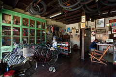 Bicycle Shop (atsushi photography) Tags: life people man bicycle wheel shopping thailand shoe chair asia southeastasia culture tire nakhonphanom northeasternregion tambonnaimueang changwatnakhonphanom