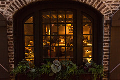 Peeking through windows at dusk HWW (Irina1010) Tags: window canon restaurant inside flowerbox goldenlight hww outstandingromanianphotographers
