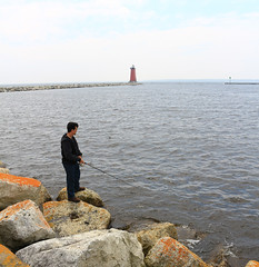 023_sq fisherman at Manistique (jgagnon63@yahoo.com) Tags: lighthouse up spring michigan may lakemichigan upperpeninsula uppermichigan redlighthouse manistique schoolcraftcounty manistiquelighthouse canonsl1 manistiqueeastbreakwaterlightstation
