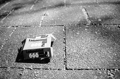 Netzteil of the beast (chipsmitmayo) Tags: blackandwhite film analog angle minolta pavement wide 666 retro ii devil boardwalk 24mm schwarzweiss papier verpackung xd7 mll f28 mnster 114 westfalen brgersteig teufel selfdeveloped weitwinkel elektro netzteil rokkor pappe adox kleinbild selbstentwickelt cms20 adotech ladeteil