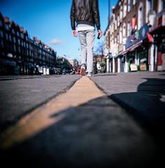 Walk the line (tripowski) Tags: street man london yellow toy holga kodak ground line highstreet portra stokenewington eastlondon yellowline portra160 kodakportra160 holgagcfn