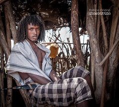 Young Afar man, Ethiopia - Jeune homme Afar, Ethiopie (Patricia Ondina) Tags: africa people beauty african tribal beaut dagger tradition anthropologie ethiopia tribe ethnic hairstyle curlyhair personne coiffure afrique hornofafrica ethnology tribu afar eastafrica thiopien etiopia ethiopie etiopa ethnologie etiopija ethnie raffinement etiopien poignard etipia etiyopya cornedelafrique afriquedelest cheveuxboucls guila