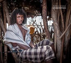 Young Afar man, Ethiopia - Jeune homme Afar, Ethiopie (Patricia Ondina) Tags: africa beauty african tribal beaut dagger tradition anthropologie ethiopia tribe ethnic hairstyle curlyhair coiffure afrique hornofafrica ethnology tribu afar eastafrica thiopien etiopia ethiopie etiopa ethnologie etiopija ethnie raffinement etiopien poignard etipia etiyopya cornedelafrique afriquedelest cheveuxboucls guila