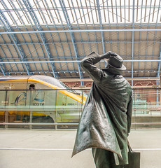 Very sad. Good-bye. (Marlytyz) Tags: statue cross eurostar railwaystation kings
