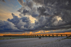 Evening Clouds Over Fishing Pier (Stuart Schaefer Photography) Tags: sunset sky cloud sun storm beach gulfofmexico water clouds outside outdoors evening pier sand florida outdoor dusk shoreline shore storms cloudscape fishingpier navarrebeach navarrebeachfishingpier
