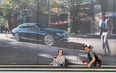 'The Glance' (Canadapt) Tags: woman man look vancouver airport bc travellers advertisement walkway mercedesbenz glance movingsidewalk travelator canadapt