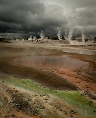 Porcelain Basis at Norris Geyser Basin, Whirligig Geyser (wildphototakermaker) Tags: green iron steam rainy pools area yellowstonenationalpark pinwheel volcanic bacteria darkclouds whirligig geysers oxide hydrothermal norrisgeyserbasin thermophiles porcelainbasinatnorris