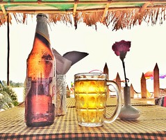 Sun. Sand. Amber-liquid.  .. All conspire to lull the soul .. (Gaurav Dinesh) Tags: fourseasonsgarden