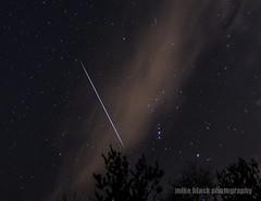 Geminid meteor streaks past Orion (Mike Black photography) Tags: new winter sky mars cloud sun black mike nature night canon stars shower space nj shore orion planet jersey hunter gemini meteor spce geminid