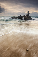 Cala de la Roca del Paller [Explored] (Ramn M. Covelo) Tags: sea sky espaa costa seascape motion beach rock vertical stone clouds marina sunrise landscape outdoors dawn coast mar spa