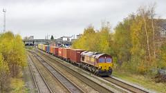 66128 Burton on Trent (mike.online) Tags: uk red yellow train gm diesel britain shed tracks rail railway rails british locomotive railways freight dbs generalmotors schenker haulage class66 ews burtonontrent dualcab heavyhaul 66128 dbschenker