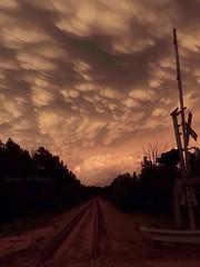 Mammatus Clouds over Valliant Oklahoma 05/09/2016 (Metallicat923) Tags: railroad sunset orange oklahoma clouds crossing boobs tracks bubble dirtroad anvil thunderstorms mammatus tornadowarning valliant