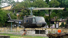 UH - 1H Huey (Mark Obusan) Tags: woman sexy girl lady legs aircraft tourist vietnam huey helicopter lonelyplanet usaf hue guidebook usarmy iroquois vietnamwar americanwar uh1 thecitadel bellhuey uh1h belluh1