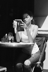 Girl and book...London (Sean Hartwell Photography) Tags: street city england london film girl 35mm reading book town cafe candid literature coventgarden fujifilm olympustrip