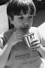 2nd Grader eating Rita's Water Ice in Logan Square Park in Philadelphia, Pennsylvania (allisonrubin) Tags: kid summer philly philadelphia lovepark ritaswaterice lifeisgood allisonkrubin wooderice waterice