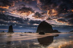Oregon Coastal Sunset (Vision & Light Photo) Tags: ocean sunset reflection beach nature water beautiful beauty rock clouds oregon poster landscape outside outdoors photography coast photo seaside artwork sand rocks colorful solitude northwest image dusk fineart shoreline wave photograph shore coastline ripples needles cannonbeach haystackrock desolate dramaticsky monolith tranquil cloudscape fineartphotography fineartphoto fineartphotograph