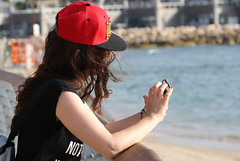 Disconnected from the real world, connected to the virtual world (Rahul Gaywala) Tags: tel aviv beach blue candid cloud girl israel mediterrerian mobile red sea sky street 500px telaviv