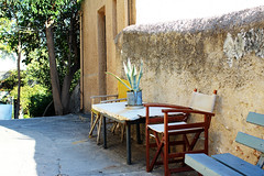 table (Katrinitsa) Tags:  anafiotika athens greece plaka architecture cityscape city neighbourhood colors morning sunlight canon traditional street streetphotography streets streetview cityview plants garden yard pots yellow wall walls table chairs bench flowers nature ef35mmf14lusm