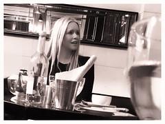 Girl in a restaurant (theimagebusiness) Tags: uk travel blackandwhite london tourism girl monochrome lunch restaurant pretty random candid blonde attractive dining theimagebusiness