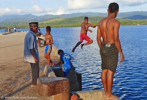 Evening water games at Pelabuhan Baranusa, Pantar island, NTT Indonesia