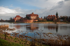 Castle of the Teutonic Order (allisonherreid) Tags: travel blue red lake castle history tourism water europe order poland polish landmark baltic historical malbork teutonic malborkcastle teutonicorder castleoftheteutonicorder