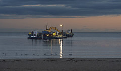 Harbor Dredge at twilight