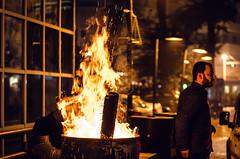 How to stay warm outside (Melissa Maples) Tags: christmas winter man night turkey fire 50mm nikon asia trkiye barrel antalya nikkor turk afs    kaleii  50mmf18g f18g d5100
