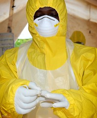 Medic in the Fight Against Ebola in Sierra Leone (Defence Images) Tags: africa uk face clothing mask military free rubber medical relief staff aid gloves doctor sierraleone westafrica british op protective medic operation defense defence disease infection ebola wilberforce humanitarianaid gritrock