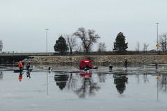 Walking on Water (Ryan Ojibway) Tags: winter reflection ice water wisconsin madison wi icefishing lakemonona danecounty