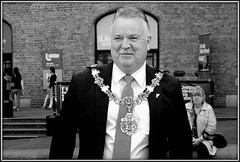 Dignitary (* RICHARD M (Over 5 million views)) Tags: street liverpool portraits mono blackwhite candid smiles unescoworldheritagesite moustache portraiture docklands mustache albertdock regalia dapper merseyside greyhair streetportraits dockland capitalofculture dignitary streetportraiture candidportraits europeancapitalofculture candidportraiture merseysidemaritimemuseum chainofoffice unescocityofmusic greymoustache unescomaritimemercantilecity steamonthedock thedanieladamson