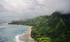 Aerial view of Kauai coast (Lena and Igor) Tags: us usa hawaii kauai coast aerial scenic clouds beach sand reef sunspots travel america osean sea water waves surf mountains haze mist dslr nikon d7000 sigma 1770 telephoto zoom lens