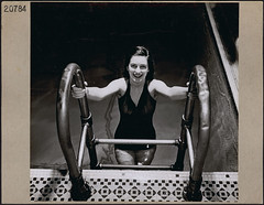 "Smiling swimmer of the Ottawa YWCA ""Aquamaids"" emerging out of the ""Y"" pool / Une nageuse souriante, membre du groupe Aquamaids du YWCA dOttawa, sort de la piscine (BiblioArchives / LibraryArchives) Tags: woman ontario canada pool swimming natation femme ottawa lac swimmer piscine bac ywca nationalfilmboardofcanada libraryandarchivescanada photothque nageuse aquamaids bibliothqueetarchivescanada frankroyal march1946 officenationaldufilmducanada mars1946"