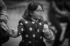 ADF_20140301_0560-2 (chiyowolf) Tags: chengdu sichuanprovince canoneos7d china ef70200mmf28lisiiusm streetscenes facesofchengdu peopleofchengdu portrait younggirl ponytail icecream holdinghands polkadots downjacket winterwear 中国 travelphotography 成都 四川
