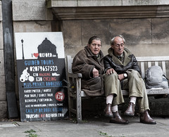 (Mis)guided tours (James Thomas 10375) Tags: oxford oxfordshire men bench seat wooden wall university shoes coats asleep sign board path pavement city street trousers canoneos5dmarkiii canon ef 2470 f28 l ii usm candid