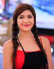 Festival Beauty (wyojones) Tags: red woman cute girl beautiful smile pretty florida expression gorgeous lips apron braids brunette lovely pigtails browneyes johnspass tresureisland seafoodfestival wyojones johnspassseafoodfestival