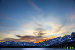 New years eve alberta sunset (DKG Images) Tags: blue winter sunset sky sun sunlight mountain snow canada nature water colors landscape evening colorful view damien explore alberta harmony goodyear yyc dkg explored dkgimage dkgimages