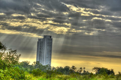 Sunrise over a lonely building (CraterValley Photo) Tags: light sun building sunrise tall panama sunrays hdr sunbeams