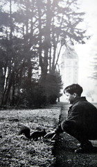 Boy and Squirrel (roomman) Tags: park old light boy shadow portrait blackandwhite bw 3 man black guy history nature animal fauna forest vintage germany buch landscape book design flora 60s squirrel style erich aerial historic 1950s sit bauer 50s bandw edition baden karlsruhe development 3rd 1950 1961 antiquariat 1960 luftbild andwhite albrecht 2014 badenwürttemberg aereal württemberg luftbilder bawü dritte brugger auflage 160s bildband 3rdedition 3auflage erichbauer