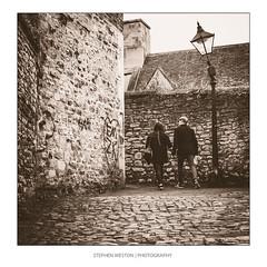Oxfords Leading Light (Stephen Weston Photography) Tags: road street old roof light people white black lamp monochrome vintage photography mono photo blackwhite fuji pics outdoor images stephen cobblestones oxford lane fujifilm weston x20 lightroom 2016 stephenwestonphotography