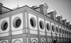 round windows (khrawlings) Tags: windows bw horse building monochrome andalucia riding round equestrian jerez fundacinrealescuelaandaluzadelarteecuestre