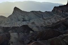 Taking in Rock Formations and Colors at Zabriskie Point (Death Valley National Park) (thor_mark ) Tags: california day2 sunset mountains nature unitedstates deathvalley blueskies goldencanyon zabriskiepoint desertlandscape lookingwest deathvalleynationalpark nearsunset sunsettime project365 colorefexpro erosionallandscape tuckimountain mountainsindistance badlandformations nikond800e mountainsoffindistance amaragosarange capturenx2edited triptodeathvalleyandcalifornia westgreatbasinranges atzabriskiepoint dailyrayofhope2016