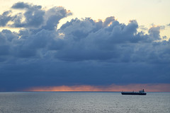 Morning Storm on the Horizon (ChristopherSmith.Photo) Tags: ocean red sky cloud sun storm color sunrise boat ship freighter