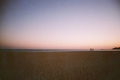 Beach Figures at Dusk (The Nick Page) Tags: sunset holiday beach portugal 35mm albufeira uws superheadz vivitarwideslim