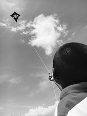boy flies a skull-and-crossbones kite on a nice, sunny and cloudy day (shot on my iPhone 6s) (norlandcruz74) Tags: filipinoamerican filam image filipino pinoy flying kite people boy apple 6s iphone norlandcruz