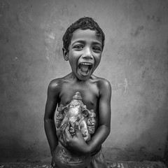 Ganapathy papa (bnw) (nshrishikesh) Tags: chennai children portrait portraits bnw monochrome mono canon canon600d candid blackandwhite blackandwhitephotography skinny happiness joy india god