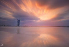 Sailing in the sunset... (Charlie_Joe) Tags: uae unitedarabemirates dubaimarina dubai burjalarab seascape sunset pink pastel sky evening reflection 360degreesrestaurant sand waves clouds rays drama canon architecture cityscape outdoor sea atlantis longexposure palmjumeirah beach wave magic landscape seaside water twilight storm weather manfrotto leefilters bigstopper